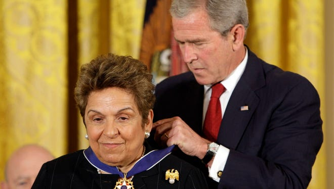 President George W. Bush places the Presidential Medal of Freedom on University of Miami president and former Health and Human Services Secretary Donna Shalala at the White House on June 19, 2008.