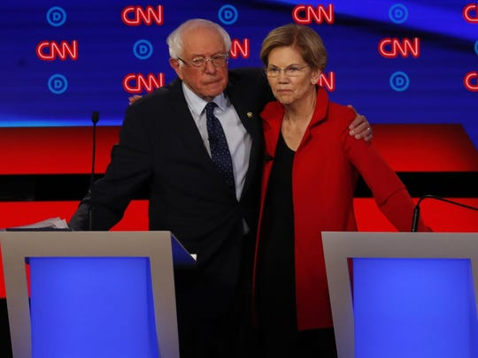 Sen. Bernie Sanders, I-Vt., and Sen. Elizabeth Warren, D-Mass., embrace after the first of two Democratic presidential primary debates hosted by CNN Tuesday, July 30, 2019, in the Fox Theatre in Detroit. (AP Photo/Paul Sancya)