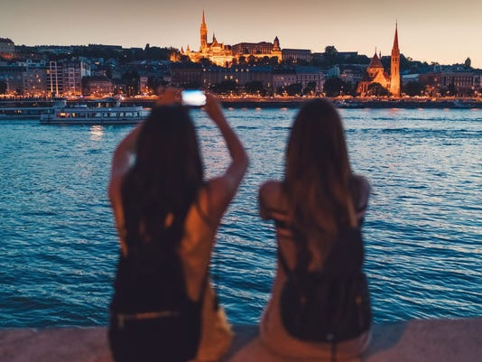 Young women in Budapest taking photos