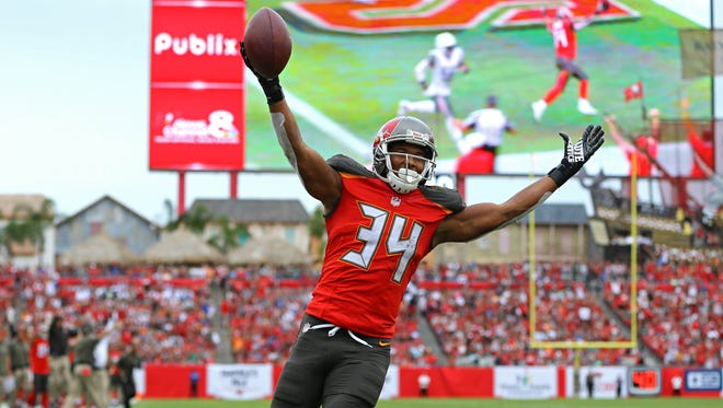Tampa Bay Buccaneers running back Charles Sims celebrates making a catch for a touchdown against the New York Jets in the second half at Raymond James Stadium.