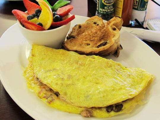 The House Omelet made with four eggs, bacon, ham, sausage,