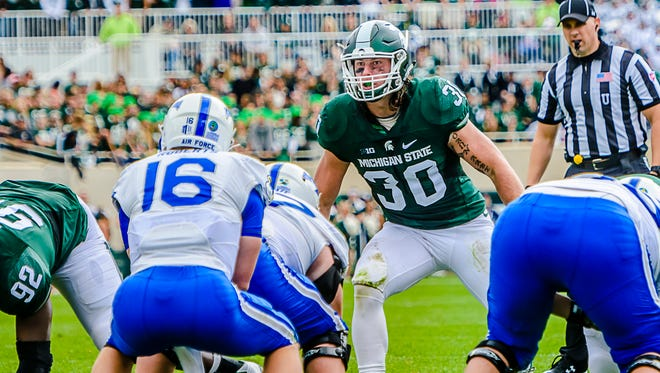 MSU middle linebacker Riley Bullough ,30, lines up over the Air Force center during their game Saturday.  Bullough contributed 16 tackles in the game.