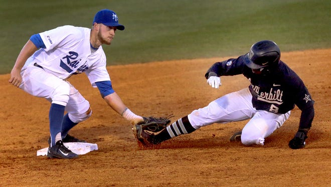 MTSU Kevin Sullivan (6) tags out Vanderbilt's Alonzo Jones (8) at second plate on Tuesday. The Blue Raiders topped the ranked Commodores 7-4.
