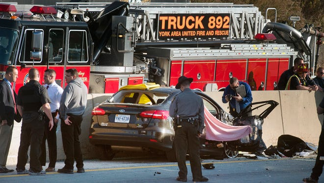 Police investigate a crash and a death in the southbound lanes of Interstate 83 in Manchester Township Tuesday.