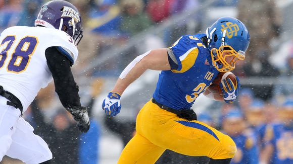 SDSU senior Zach Zenner (right) is a candidate for the Walter Payton Award, given to the top offensive player in the FCS.