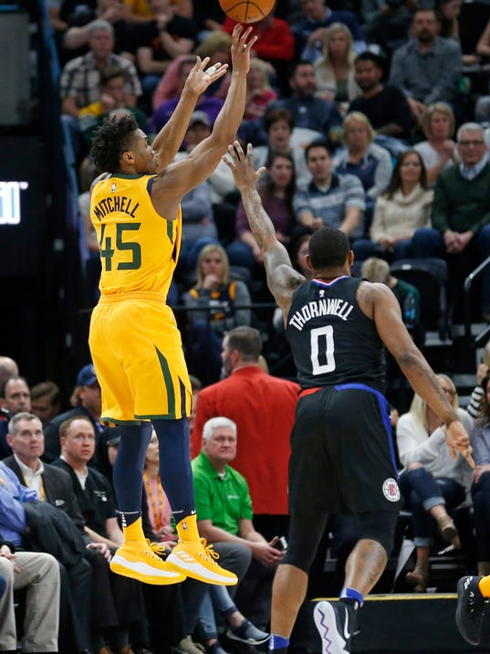 Utah Jazz guard Donovan Mitchell (45) shoots as Los Angeles Clippers guard Sindarius Thornwell (0) defends in the first half during an NBA basketball game Thursday, April 5, 2018, in Salt Lake City. (AP Photo/Rick Bowmer)
