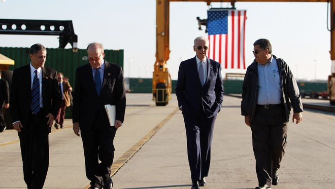 Deputy Secretary of Transportation Victor Mendez, from left, Rep. Steve Cohen, Vice President Joe Biden and Norfolk Southern division manager Gary Ricard walk together at the Norfolk Southern Memphis Regional Intermodal Facility in Rossville, outside of Memphis, Tenn., to commemorate the 7th anniversary of the American Recovery and Reinvestment Act on Wednesday, Feb. 17.