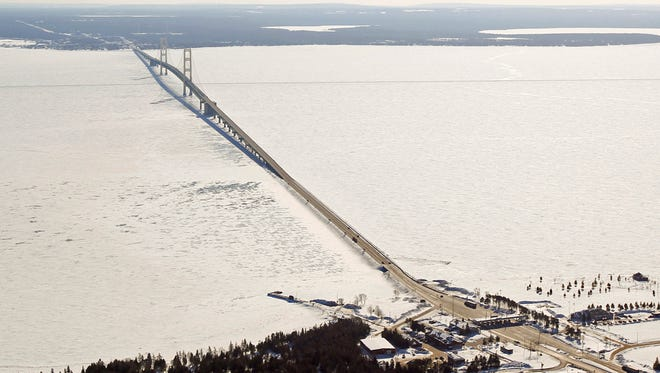 Aerial file photo of the Mackinac Bridge, which spans a 5-mile-wide freshwater channel called the Straits of Mackinac that separates Michigan's upper and lower peninsulas. Officials say hundreds of gallons of potentially toxic coolant fluid have leaked from electric power cables in the waterway that links Lake Huron and Lake Michigan.