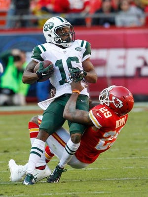 Jets wide receiver Percy Harvin is pulled down by Chiefs safety Eric Berry (29) on Sunday in Kansas City, Mo.