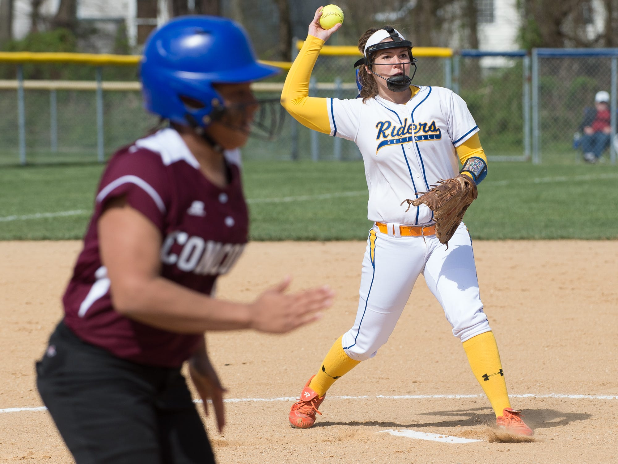 Caesar Rodney's pitcher Alyssa Ball (9) throws out a Concord runner at first base in the first inning.
