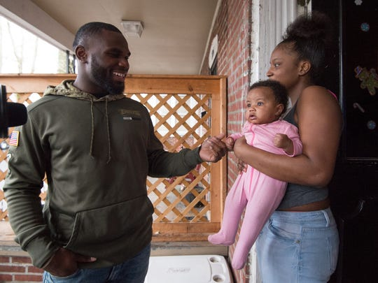 Rayvanna Smith Charles, 15, and her daughter Av'erionna Martin of Wilmington meet with Eagles running back Wendell Smallwood after receiving Christmas gifts.