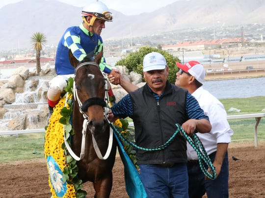 Jockey Tracey J. Hebert is congratulated atop Runaway Ghost upon approaching the winner's circle at the end of the Sunland Derby on Sunday.