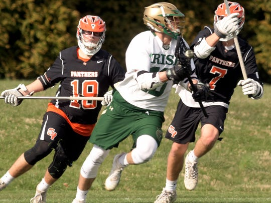 York Catholic's Cole Witman, center, has now committed to play college lacrosse for the University of Tampa, an NCAA Division II program. Witman had previously been committed to Johns Hopkins, an NCAA Division I power.