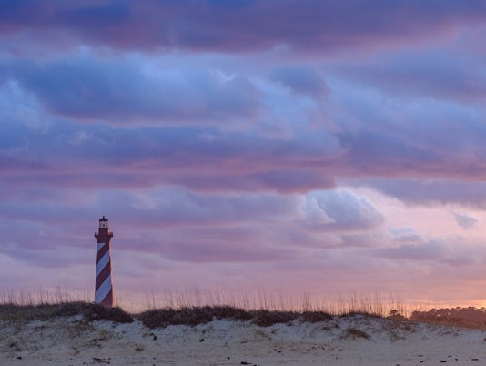 Sunset and spectacular colorful clouds on the gorgeous Cape hatteras Lighthouse on the Outer Banks