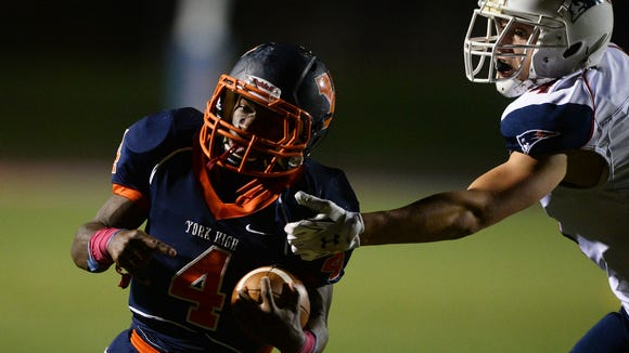 William Penn's Zack Ingram is pulled down just shy of the end zone on Friday against New Oxford Jordan Gardner during the football game at Small Field in York Friday, October 24, 2014. Ingram went on to score on the next play. He scored four touchdowns for the bearcats, helping William Penn beat New Oxford 43-7. (Photo by Kate Penn -- Daily Record/Sunday News)