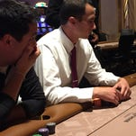 Channel 11 meteorologist Chris Vickers, right, stacks his chips as Robert Shiels looks on during the Hollywood Casino Media Challenge Poker Event.