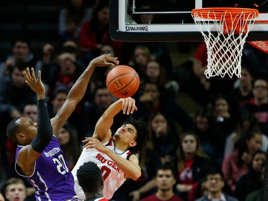 Rutgers Scarlet Knights guard Geo Baker (0) blocks