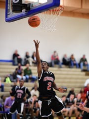 Going in for a layup during Thursday's varsity boys
