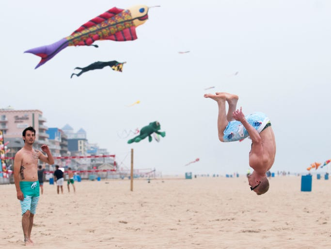 Austin Haas, 19, a student at Kutztown in Pennsylvania, lands a backflip on the beach in south Ocean City.