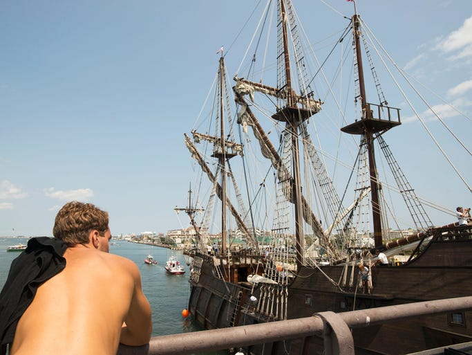 Ocean City resident Myles Deppe watches as Spanish tall ship El Galeon Andalucia sails through the Rt. 50 bridge Wednesday, July 30.