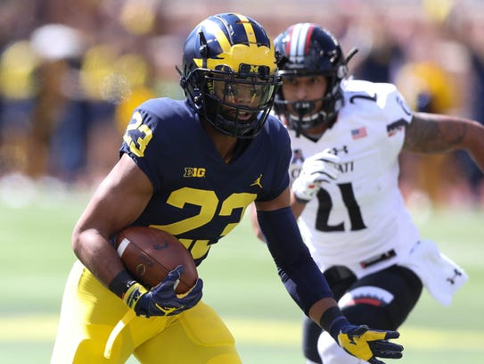 Michigan's Tyree Kinnel runs back an interception for
