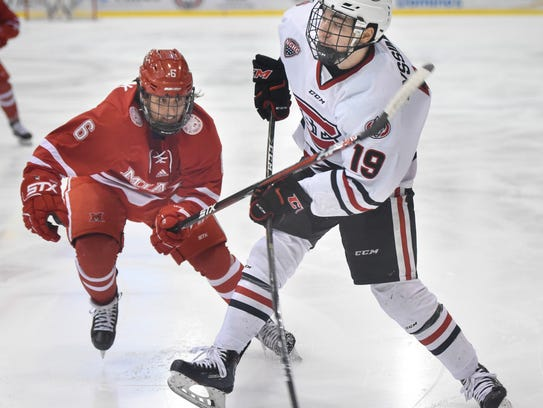 St. Cloud State's MIkey Eyssimont takes a shot against