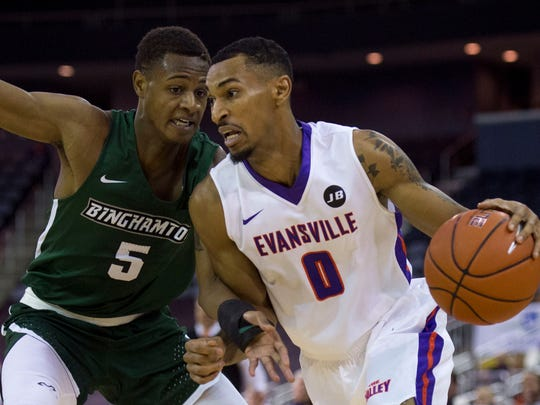 Binghamton's University's Tyler Stewart (5) defends University of Evansville's Ryan Taylor (0) as the University of Evansville Purple Aces take on the Binghamton University Bearcats at the Ford Center in Evansville, Ind., on Saturday, Nov. 18, 2017.
