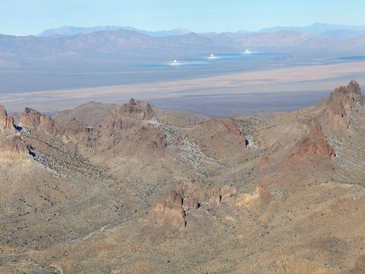 The Castle Peaks rise high above the desert floor.