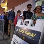 Shoppers wait in line to enter Best Buy on Thursday. Many stores opened Thursday night to kick off Black Friday shopping.