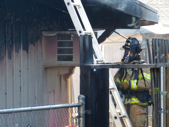 Fire officials say discarded ashes from a wood stove caused a fire that damaged a Redding home Monday off Bechelli Lane.