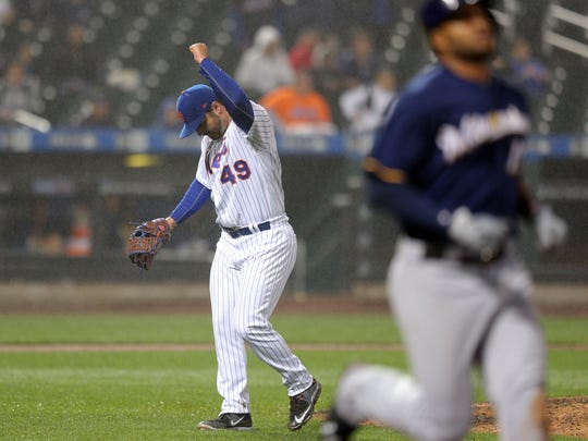 Mets relief pitcher Josh Smoker (49) reacts after getting Milwaukee Brewers right fielder Domingo Santana (16) to ground out during the eleventh inning at Citi Field. The Mets went on to win the game 5-4 in the 12th inning on Tuesday, May 30, 2017.