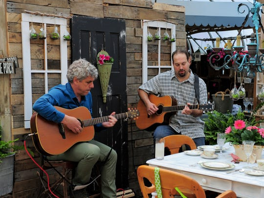Musicians Barry Hollander and Nick Tropiano perform during a farm-to-fork dinner at Johnson's Corner Farm.