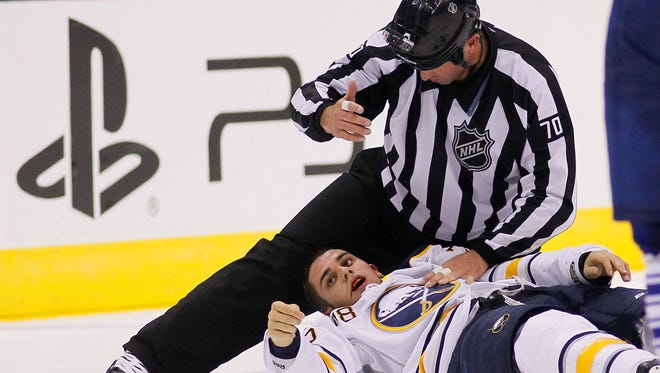 Buffalo Sabres forward Corey Tropp was injured during a fight and it sparked a line brawl.