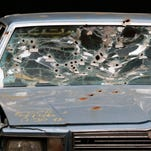 This April 10, 2015 file photo shows the car that was driven by Timothy Russell in Cleveland. Cleveland officials said Tuesday, Jan. 26, 2016, that they're firing six police officers involved in a 137-shot barrage that killed two unarmed people after a high-speed chase.
