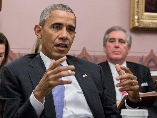 Jerry Abramson looks on as President Barack Obama speaks