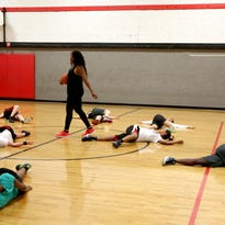 Former McKay and Oregon State basketball player Anna Marchbanks, left, leads the North Salem High School girl's basketball practice as head coach on Wednesday, June 22, 2016.