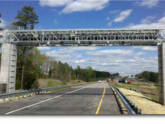 North Carolina uses overhead gantries containing radio frequency readers and video cameras to charge toll road users a toll or fee.
