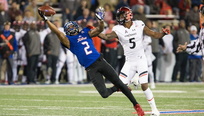 Tulsa Golden Hurricane wide receiver Keevan Lucas (2) makes a one-handed catch downfield while being defended by Cincinnati Bearcats safety Mike Tyson (5) at Skelly Field at H.A. Chapman Stadium.