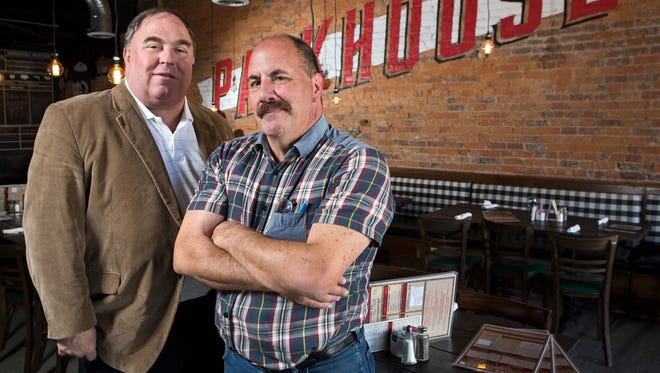 Owners Bob Conway (left) and Mark Schultz pose in their restaurant, Packhouse Meats, in Newport.