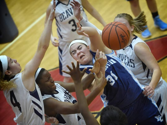 Christian School of York's Kaitlyn Hess becomes tangled in the Lebanon Catholic defense driving to the hoop and is fouled. The Beavers of Lebanon Catholic defeated the Crusaders of Christian School of York, 59-36, Tuesday in the District 3 Class A semifinals.