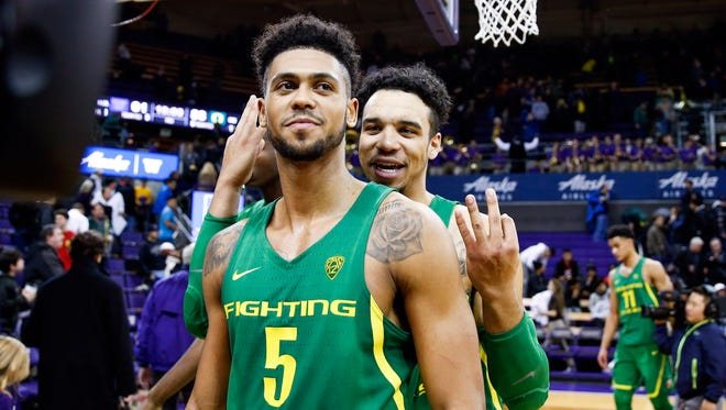 Oregon's Dillon Brooks gestures behind teammate Tyler Dorsey's back after Dorsey made eight 3-pointers Wednesday night in a Pac-12 victory against Washington.