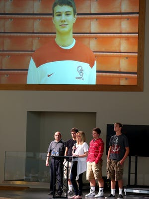 Jeanine Motsay speaks about her son Sam during a community forum about synthetic drug Nbome at Greenwood Community Church, on Aug. 5, 2014, in Greenwood. Sam was a student at Center Grove High School when he overdosed on Nbome.