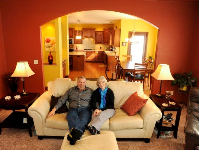 Mark and Anne Swanson pose together in the great room at their home located in the Mosie Court subdivision on the north side of Manitowoc. Photo taken on Friday, March 7, 2014.