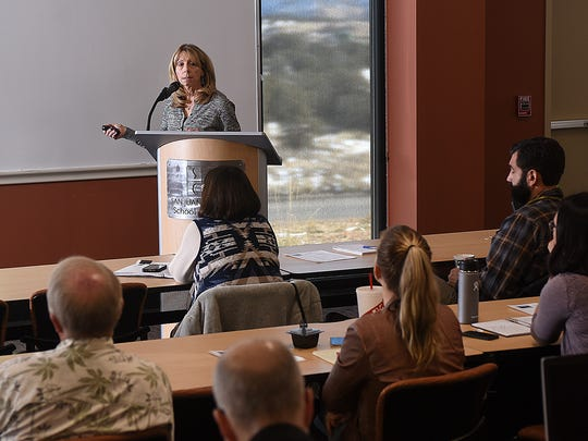 Maureen Gannon, executive director for environment and safety at Public Service Co. of New Mexico, speaks about emissions at the San Juan Generating Station on Thursday at the Four Corners Air Quality Group meeting at the San Juan College School of Energy in Farmington.