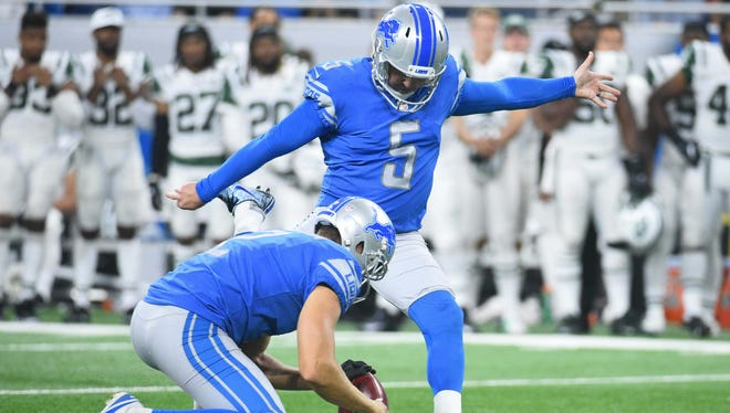 Lions kicker Matt Prater kicks a field goal as punter Kasey Redfern holds in the fourth quarter of an exhibition game against the Jets at Ford Field on Aug. 19, 2017.