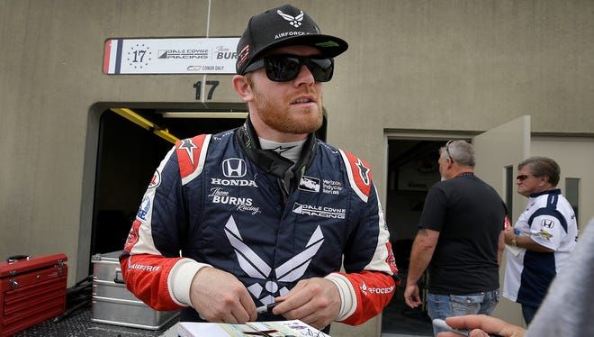 Dale Coyne Racing IndyCar driver Conor Daly (17) signs autographs for fans before practice at the Indianapolis Motor Speedway on Sunday, May 21, 2018.