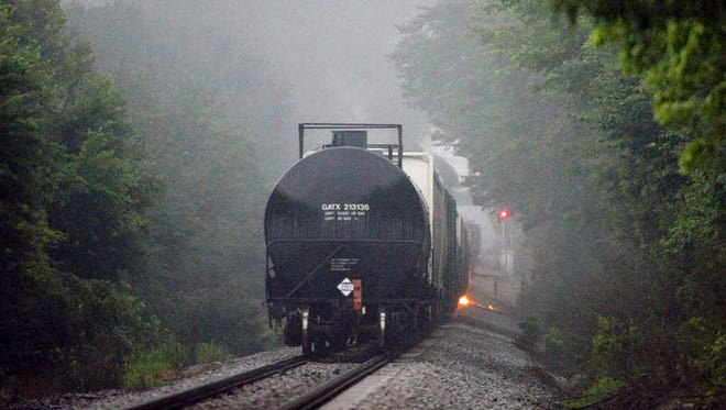 Flames are shown July 2, 2015, coming from a CSX train carrying flammable and toxic material that derailed near Maryville, Tenn.