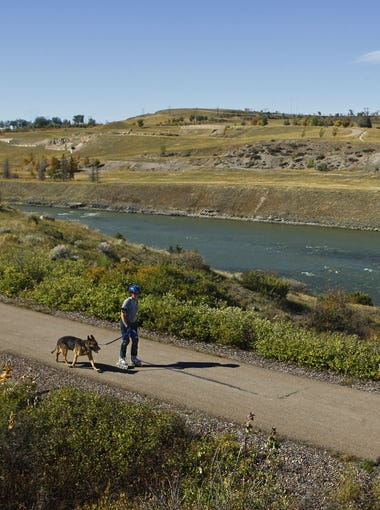 Jessica Poindexter rollerblades with her dog, Gabriel, along the River's Edge Trail.