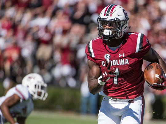 South Carolina wide receiver Deebo Samuel (1) picks up yardage against the Massachusetts defense during the first half of an NCAA college football game Saturday, Oct. 22, 2016, in Columbia, S.C. (AP Photo/Sean Rayford)