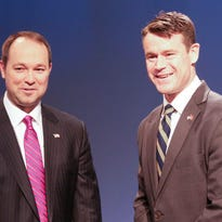 U.S. Representatives Marlin Stutzman (left) and Todd Young greet each other before a Senate Republican primary debate on April 18, 2016, at WFYI-20.